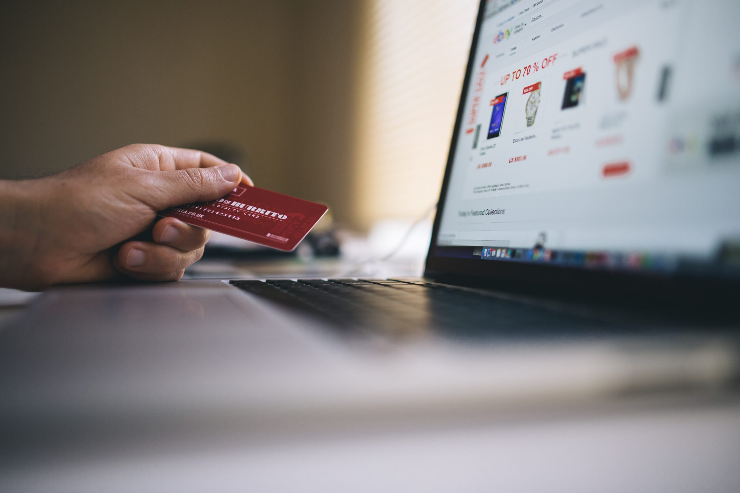 Person shopping online using a payment card